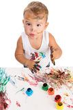 Little boy painting with hands Stock Photos
