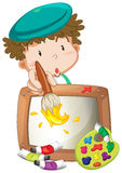 A little boy painting Stock Image