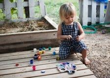 Little boy painting paints Stock Image
