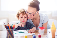 Little boy painting picture for mother Stock Photo