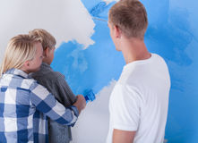 Little boy painting wall Stock Images