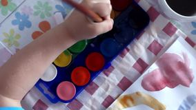 Little boy painting stock video footage