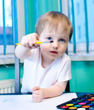 Little boy painting with watercolors. Cute little boy painting with watercolors Royalty Free Stock Photo
