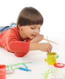 Little boy paints Royalty Free Stock Photos
