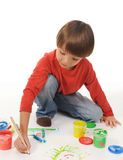 Little boy paints Stock Photography