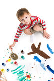 Little boy with paints Royalty Free Stock Image
