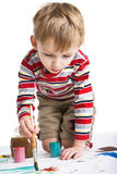 Little boy with paints Stock Photography