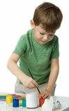 Little boy with paints Stock Images