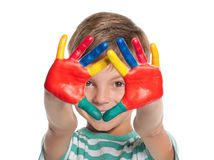Little boy with paints on hands Stock Photos