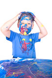 Little boy paints his self with colors Royalty Free Stock Image