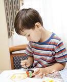 Little boy paints Stock Photo