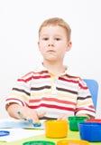 Little boy paints paints Royalty Free Stock Photo