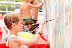 Little boy paints on the wall. Little boy paints on the white wall Royalty Free Stock Images