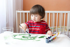 Little boy paints Royalty Free Stock Photo