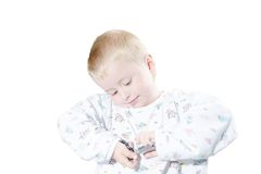 Little boy in a pajamas plays with keys isolated Stock Image