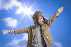 Little boy with a paper airplane. Stock Photos
