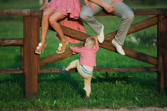 Little boy with parents outdoors Royalty Free Stock Image
