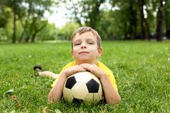 Little boy in the park with a ball Royalty Free Stock Photos