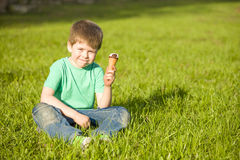 Little boy in  park eating ice cream Stock Images