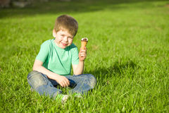 Little boy in  park eating ice cream Royalty Free Stock Photos