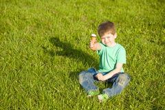 Little boy in  park eating ice cream Stock Photography