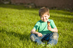 Little boy in  park eating ice cream Stock Photo