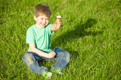 Little boy in  park eating ice cream Royalty Free Stock Images