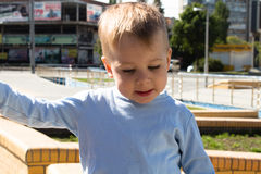 Little boy in the park face expression. A little boy in the park face expression royalty free stock image