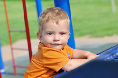 Little boy in the park facing forward Royalty Free Stock Photography