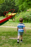 Little boy in the park playground on summer day Stock Image