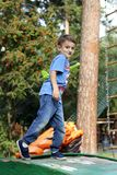 Little boy in the park. Playing with a children`s airplane stock image
