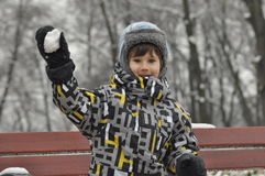 The little boy in the park in winter. Child in a cap and gloves Stock Photography