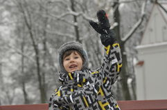 The little boy in the park in winter. Child in a cap and gloves. Royalty Free Stock Photo