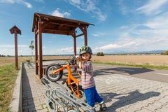 Little boy parked in bike rack. Stock Image