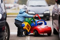 Little boy on parking Royalty Free Stock Image