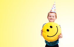 Little boy in party hat Stock Photo