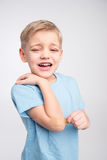 Little boy with patch on elbow Royalty Free Stock Photo