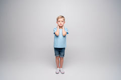 Little boy with patches on elbows Royalty Free Stock Image