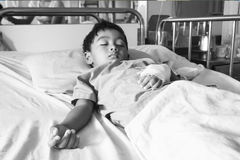 Little boy on the patient on the bed Stock Images
