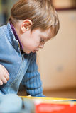 Little boy paying at home. Toddler having some fun indoors playing with his toys Stock Image