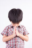 Little boy paying respect Royalty Free Stock Photography