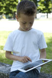 Little boy with PC tablet Stock Photo
