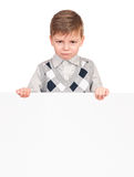 Little boy peeking from blank board Stock Photo