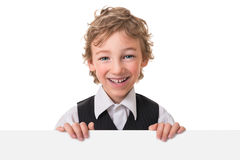 Little boy is peeking from blank sign Stock Images