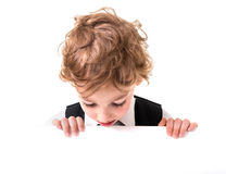 Little boy is peeking from blank sign Stock Image