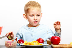 Little boy peeling apple cooking at home. Stock Images