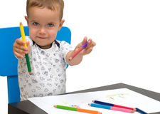 Little boy and pencils Stock Photos