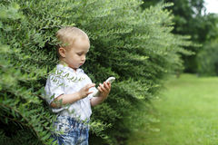 Little boy with a phone Stock Photo