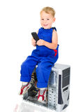 Little boy with phone on a PC Royalty Free Stock Images