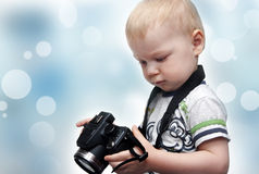 Little boy with photo camera Stock Images